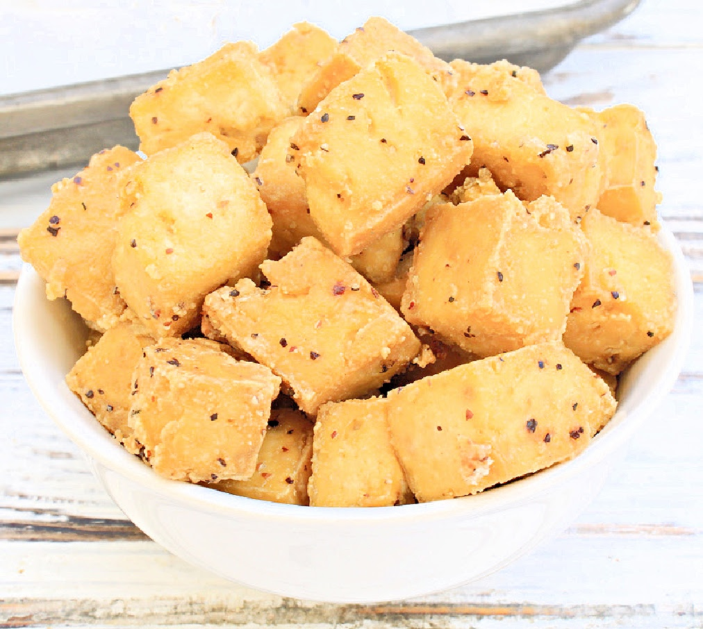 Crispy Baked Tofu ~ Cubed tofu tossed with simple seasonings and baked to golden perfection. Uncomplicated, flavorful, and so easy!