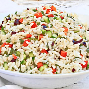 Italian Rice Salad ~ A light and easy grain salad with spinach, peppers, cucumbers, and olives tossed in Italian-style dressing.