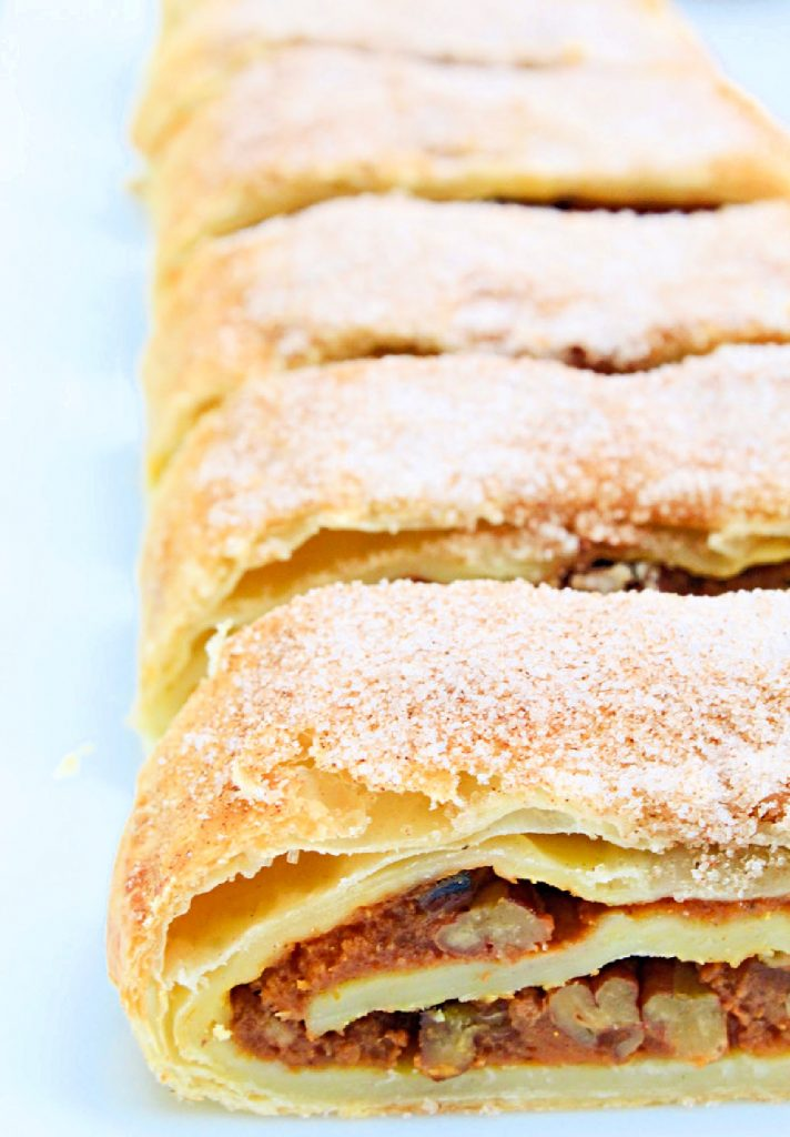 Pumpkin Strudel ~ Puff pastry dough is layered with pumpkin, walnuts, and savory spices of the season then baked until golden!