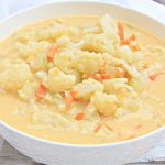 Cheesy Cauliflower Soup ~ A creamy, flavorful, dairy-free soup loaded with cauliflower and vegan cheddar. Ready to serve in under 30 minutes!