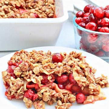 Cranberry Apple Crisp ~ You'll love this easy dessert that celebrates the flavors of fall with sweet apples, tart cranberries, seasonal spices, and a buttery oat topping!
