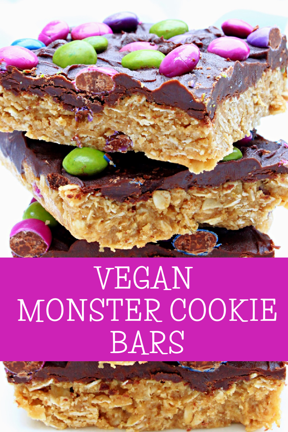 Vegan Monster Cookie Bars ~ Peanut butter and oatmeal cookie dough smothered in chocolate and studded with colorful candies is an easy, no-bake dessert treat that is frightfully delicious! via @thiswifecooks